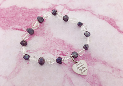 Bracelet with two-coloured gemstones and silver heart charm