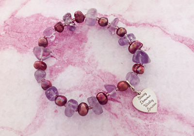 Bracelet with purple gemstones and silver heart charm