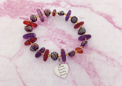 Bracelet with warm colors gemstones and silver heart charm