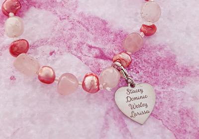 Bracelet with pink gemstones and silver heart charm