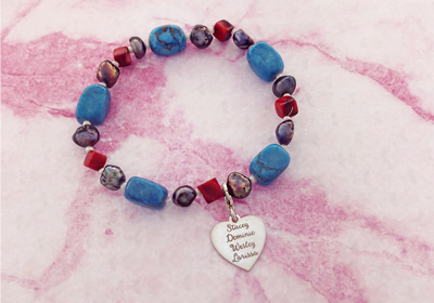 Bracelet with blue gemstones and silver heart charm