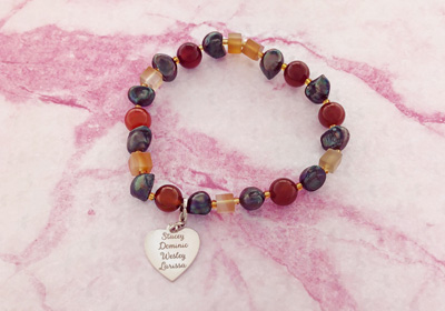 Bracelet with earth tones.gemstones and silver heart charm